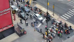 A group of dirt bike riders on North Broad Street in May 2020