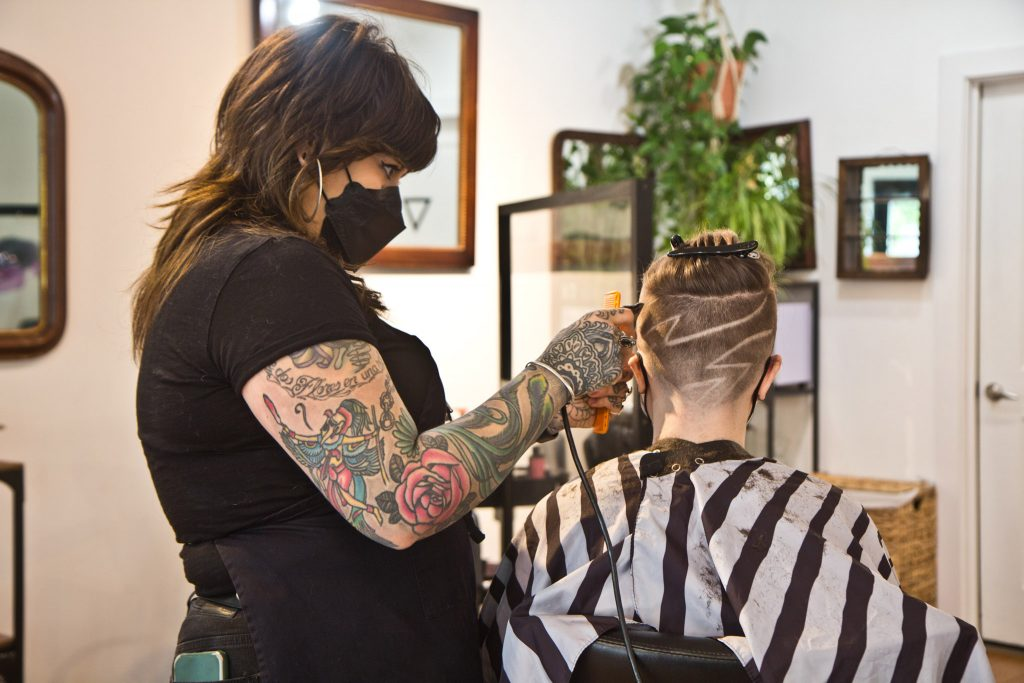 Transfiguration Hair Studio Owner Angel Indelicato cuts the hair of Ava Sambriski