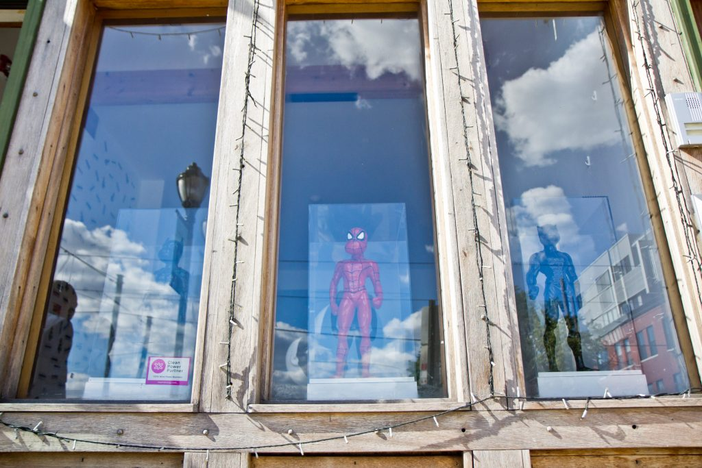 Sculptures of Batman, Spiderman, and the Black Panther by artist Zevi G in the window of Art From the Heart