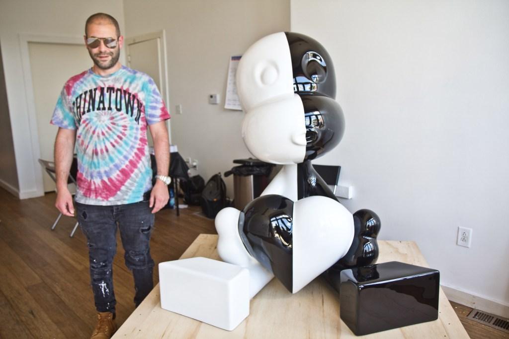 Artist Zevi G with his sculpture 'Messenger'