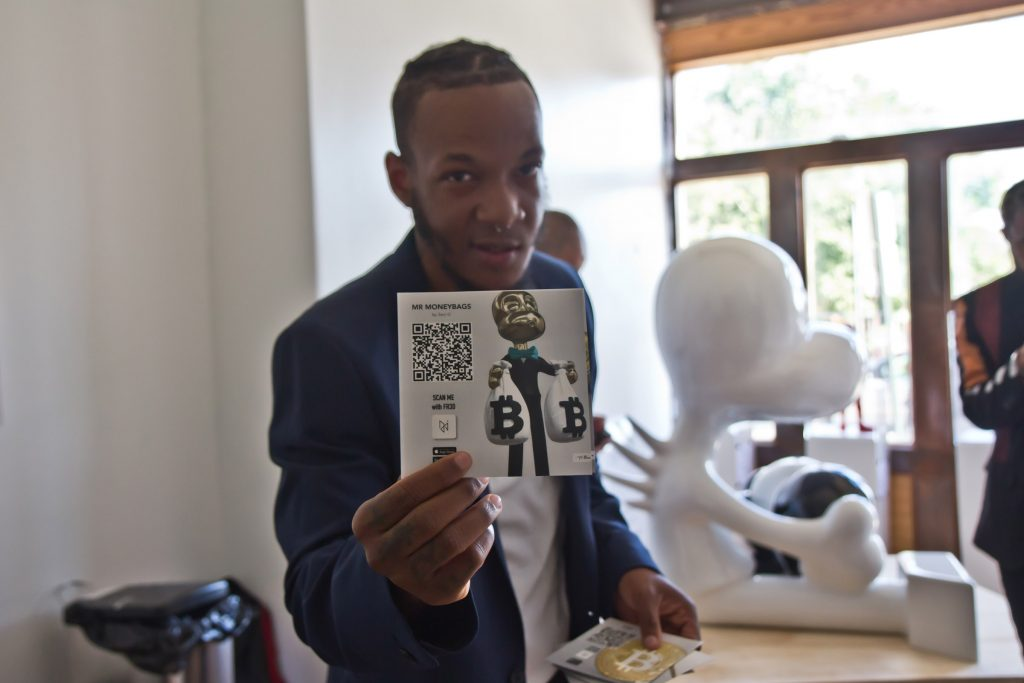 Darnell Schoolfield holds one of the cards visitors receive to begin playing the gallery's augmented reality scavenger hunt