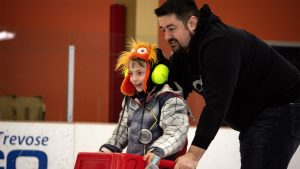 A father and son participate in the Autism Skate Night at Tarken Recreation Center in the Northeast