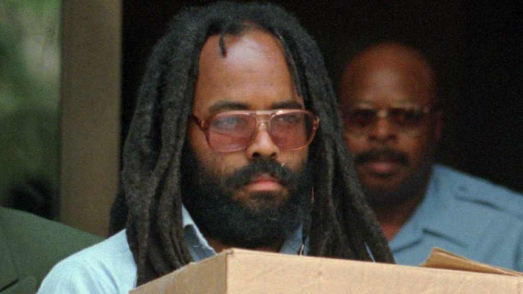Mumia Abu-Jamal leaves City Hall after a hearing in June 1995