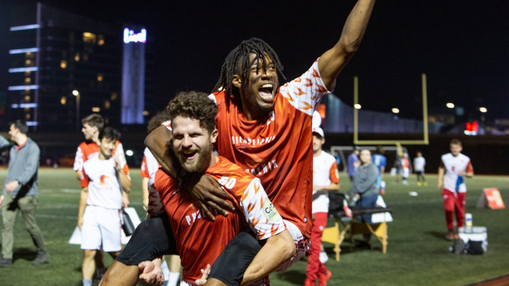 Veteran Phoenix Eric Witmer picks up newbie Phoenix player Nate Little in celebration after their 21-16 win over the Tampa Bay Cannons