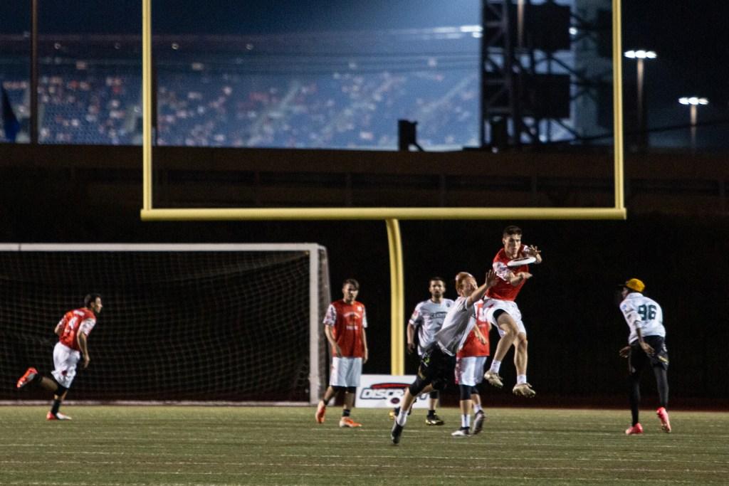 Phoenix Scott Heyman makes a huge jump to make a catch despite the best efforts of a Tampa Bay defender