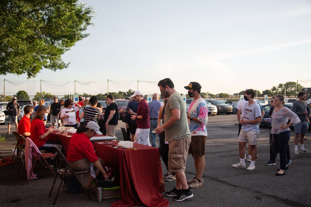 Fans line up to buy a ticket or season pass