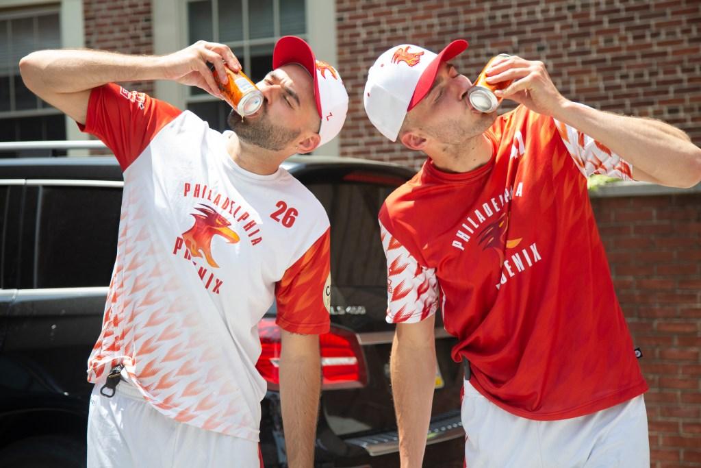 Phoenix players Colin Masino (left) and Matt Ballman shotgun their first beer at a preseason Philadelphia Phoenix team lunch on May 22