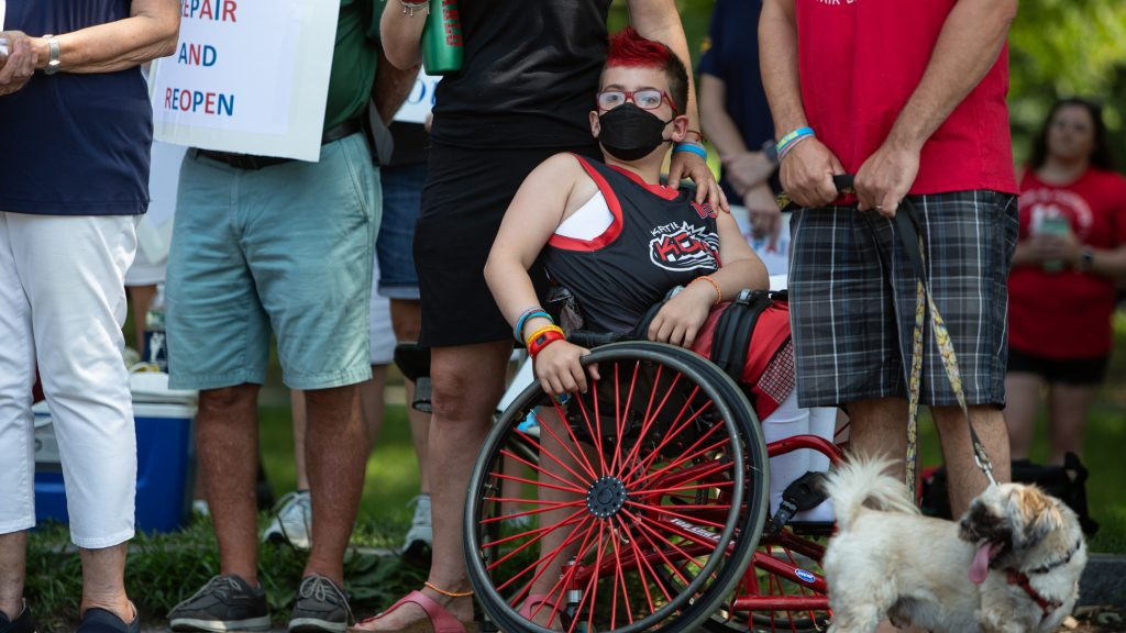 A young player of Katie's Komets, a co-ed wheelchair basketball team, at a July protest to save the Carousel House