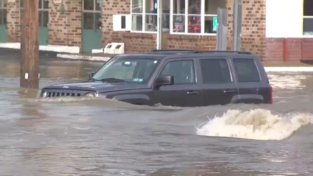 A car stuck in the torrents on July 13