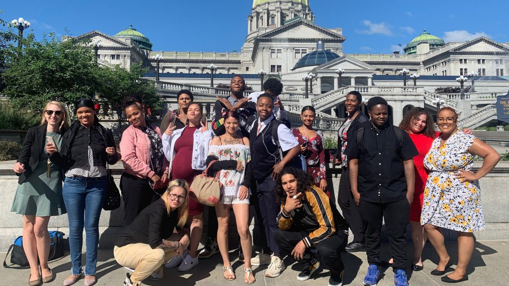 Participants of the youth advocacy programs at Philadelphia's Juvenile Law Center pose at the Pa. State Capitol with program managers Cathy Moffa (L) and Marcía Hopkins (R)