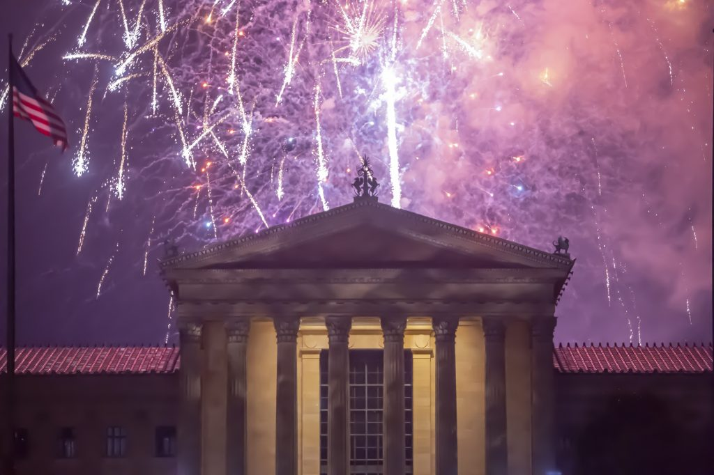 Fireworks cascade behind the central portico of the Philadelphia Museum of Art