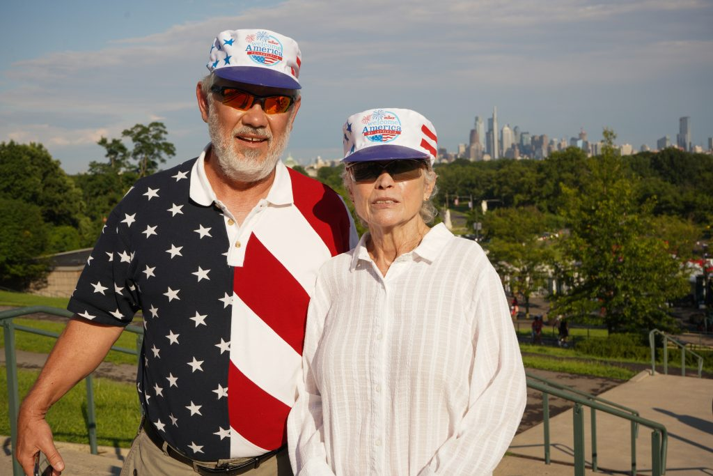 A couple who traveled from Houston to celebrate the Fourth in Philly waits outside the Mann