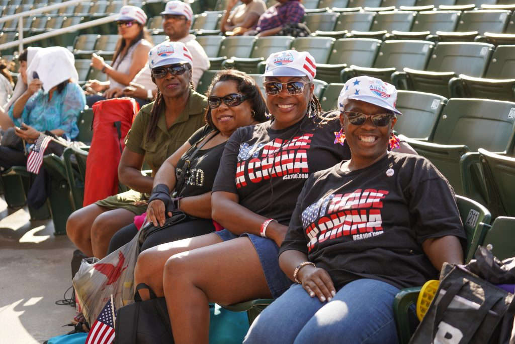 A family wearing 'Not made in China' tees poses at the start of the Mann Center concert