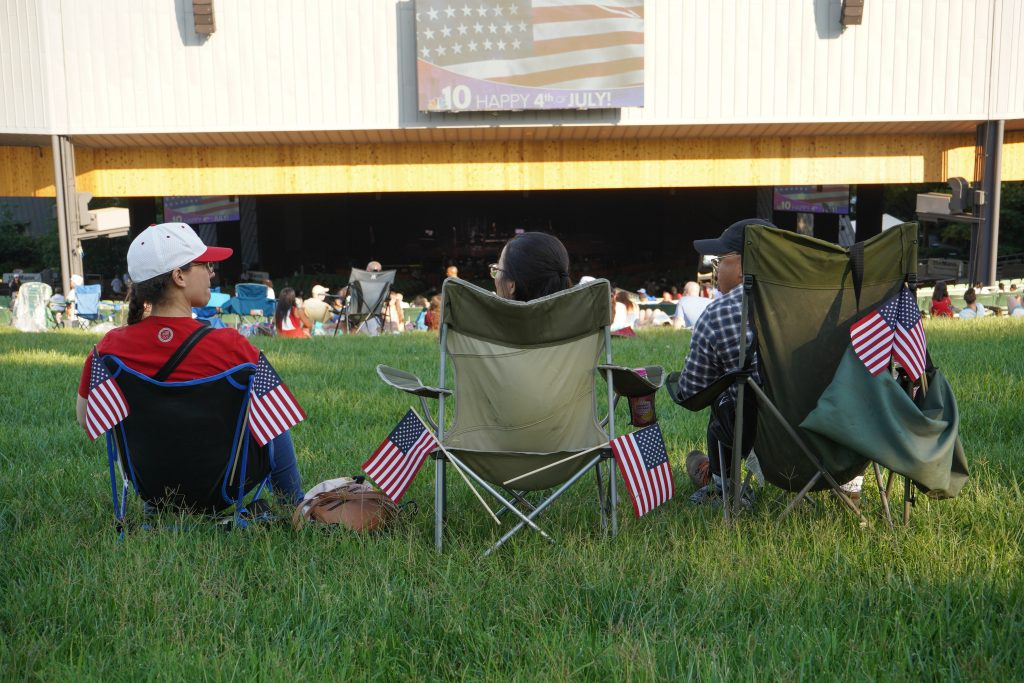 A family on the Mann Center lawn before the concert