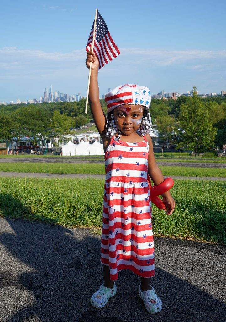 A little girl shows off her American flag colors