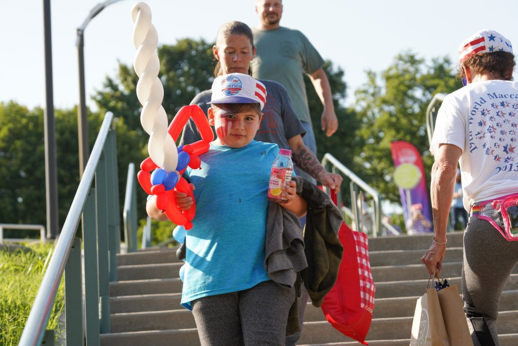 Kids could pick up patriotic balloon animals as they waited for the music to start at the Mann