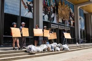 Ya Fav Trashman and partners dump litter at Mayor Kenney's feet to highlight city trash failures