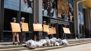 Terrill Haigler aka Ya Fav Trashman led a protest on the steps of Philadelphia's Municipal Services Building demanding clean streets, better pay for sanitation workers and the resignation of Streets Department Commissioner Carlton Williams. (Kimberly Paynter/WHYY)