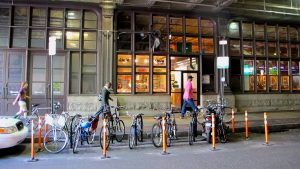 A bike corral in place of former car spots outside Reading Terminal Market
