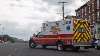 An ambulance at Kensington and Lehigh leaves on a dispatch call