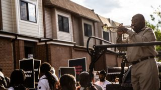 On May 13, 2021, trumpet player Kenneth Taylor played as protesters marched in honor of the lives of 11 people who died when the city bombed MOVE's West Philly house in 1985