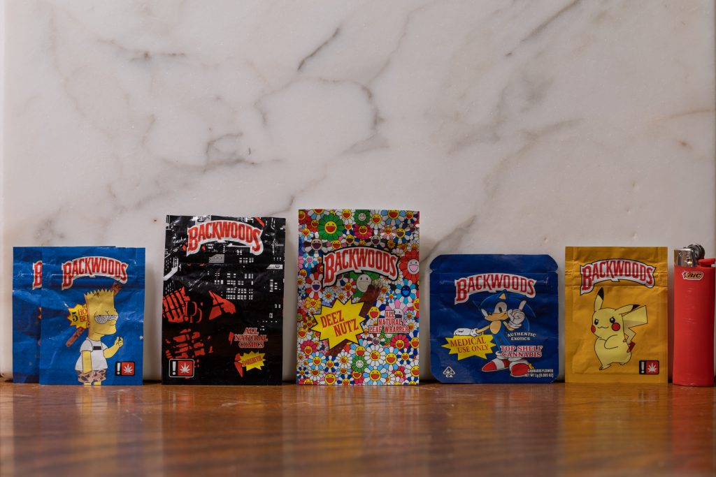 The Backwoods logo on bags featuring Bart Simpson, Daredevil, 'Deez Nutz,' Sonic the Hedgehog, and Pikachu