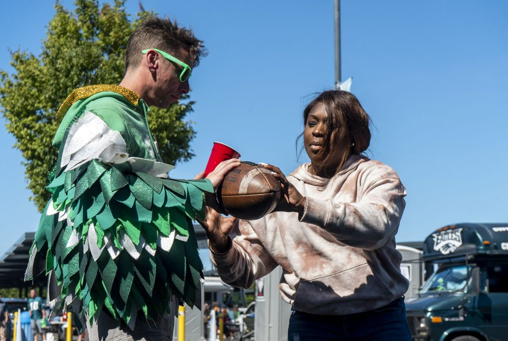 Fans played beer pong, cornhole, and plain old catch, like Justyn Myers and Selina Hawkins