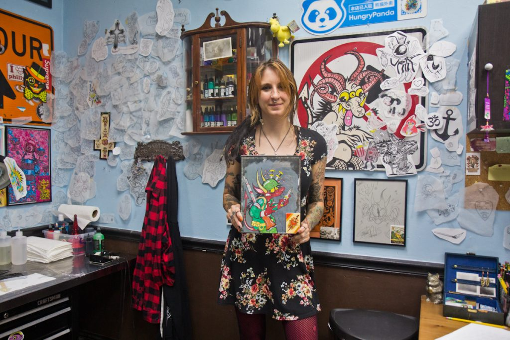 Kelly Campanile with her artwork at Eddie's Tattoo in Philadelphia's Chinatown neighborhood on August 25, 2021. (Kimberly Paynter/WHYY)