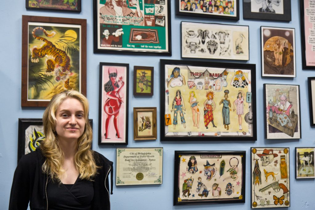 Brianna Ballinghoff with her artwork at Eddie's Tattoo in Philadelphia's Chinatown neighborhood on August 25, 2021. (Kimberly Paynter/WHYY)
