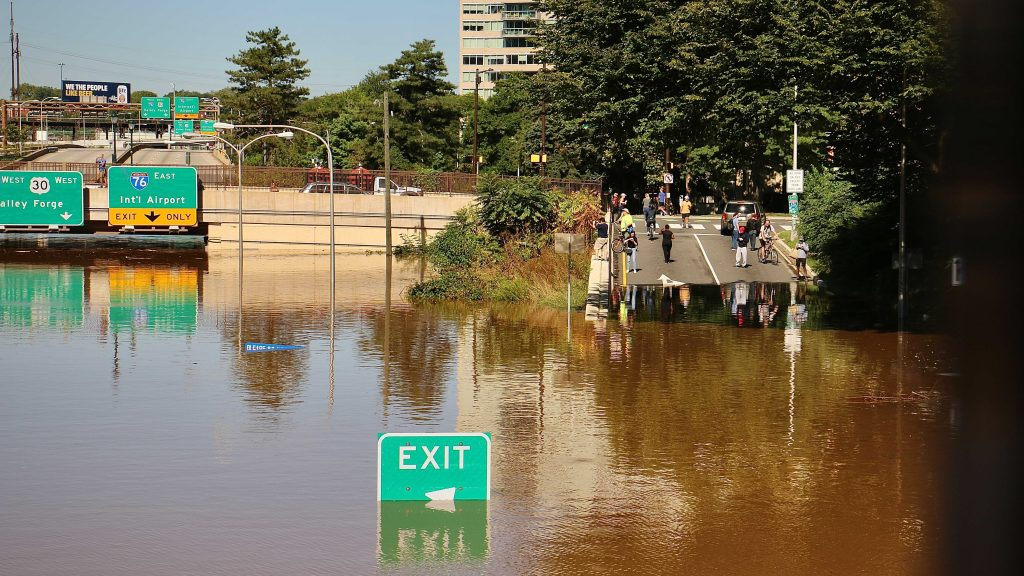Flooding closes the Vine Street Expressway from Broad Street to the Schuylkill River.