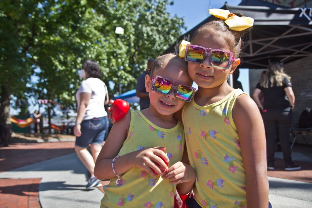 Sisters Sheilys, 5, (left) and Keilys, (right) 6, dressed their best to celebrate their heritage at Stroll the Harbor