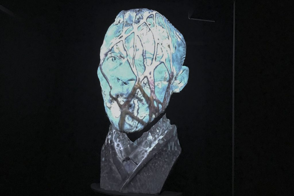 A giant 3-D head featured ever-changing projections
