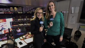 Kate Scott, left, with AJ Mleczko during their all-female broadcast of an NHL hockey game in March 2020