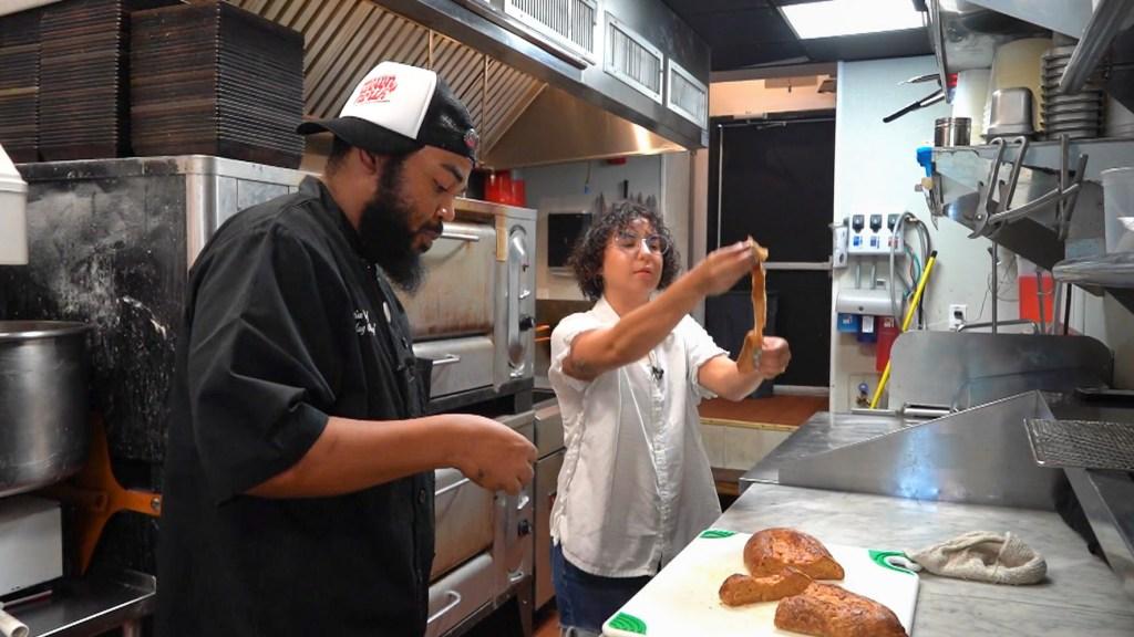 Chef Michael Carter and author Alisha Miranda pull apart the non-pork lard bread at Down North Pizza